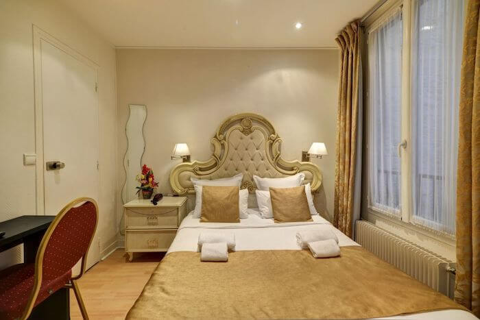 Quarto do Hotel Pavillon de Montmartre em Paris