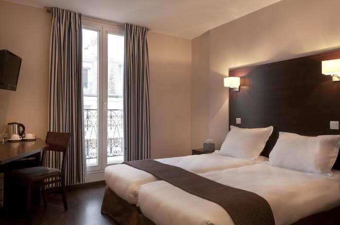 Quarto do Hotel Verlaine em Paris