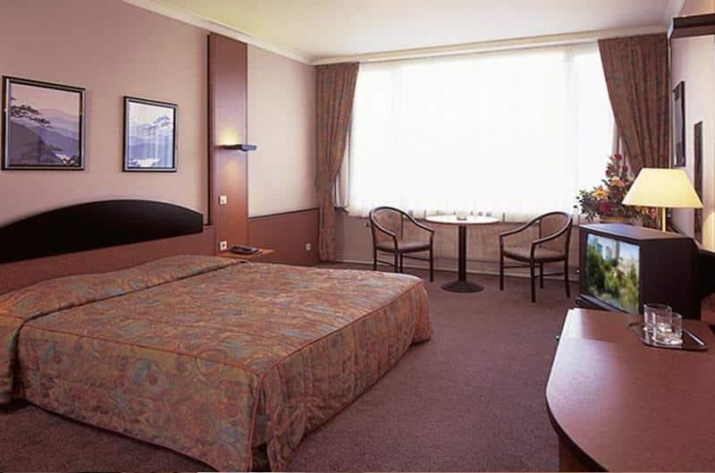 Quarto do Chaochow Palace Hotel em Bruxelas